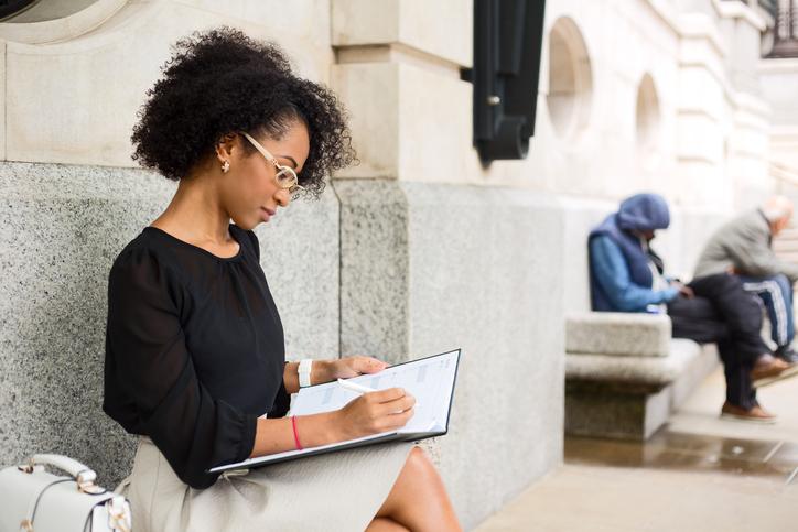 African American woman journaling