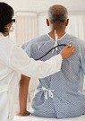 older man getting a checkup
