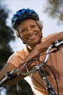older african american woman leaning on bike handle bars