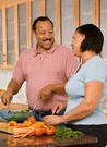 couple in the kitchen preparing meal
