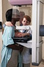 african american woman getting a mammogram