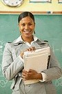 smiling african american teacher in classroom