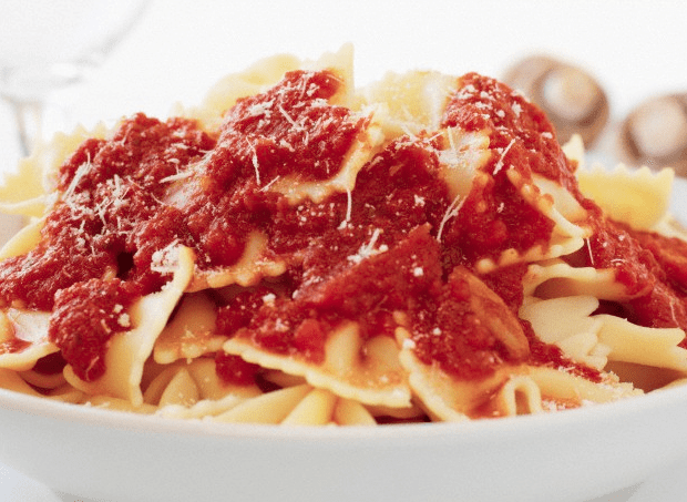 Tomato sauce on top of pasta