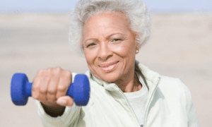older african american woman holding a hand weight