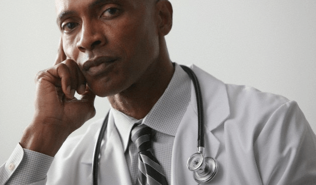A doctor making a serious expression