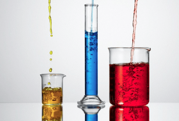 Beakers and tubes filled with colorful chemicals