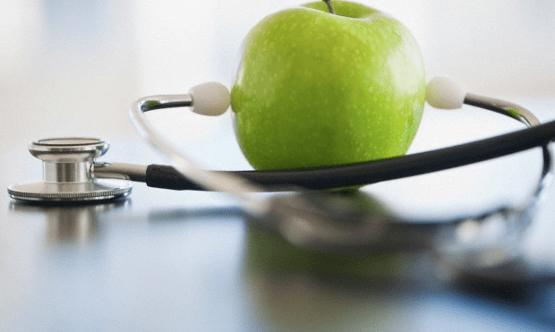 An apple attached to a stethoscope