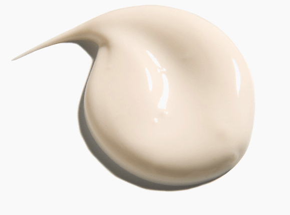 A dollop of beauty cream against a white background