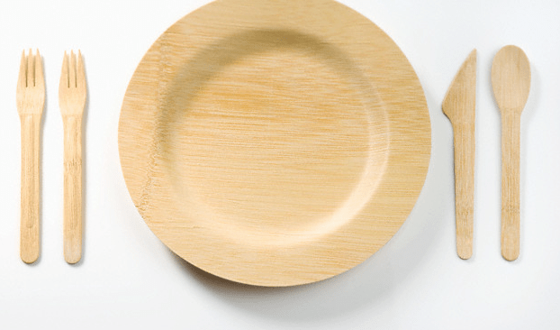 A bamboo plate and eating utensils