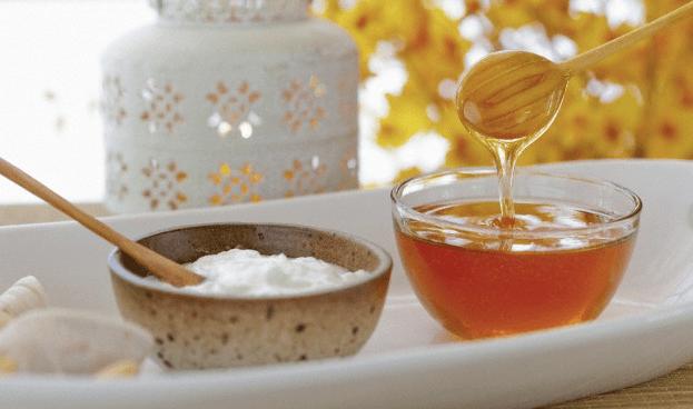 Bowls of honey and yogurt on a tray