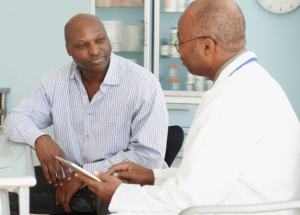 A man talking to his male doctor in his office