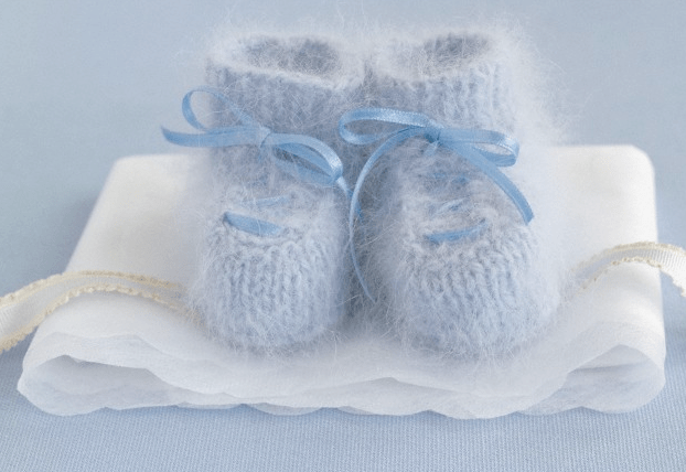 A pair of knitted blue baby booties