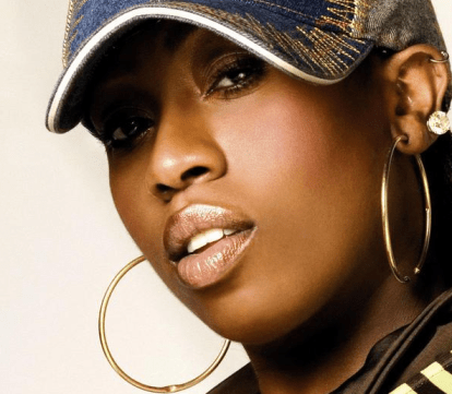 Missy Elliott wearing gold hoops
