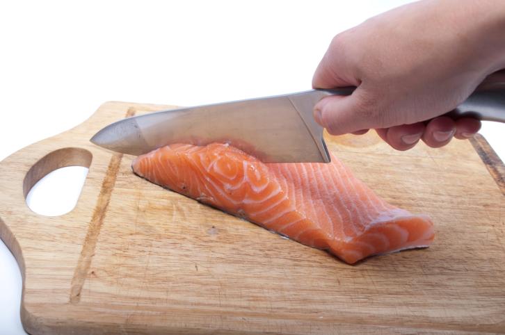 cutting salmon on a cutting board