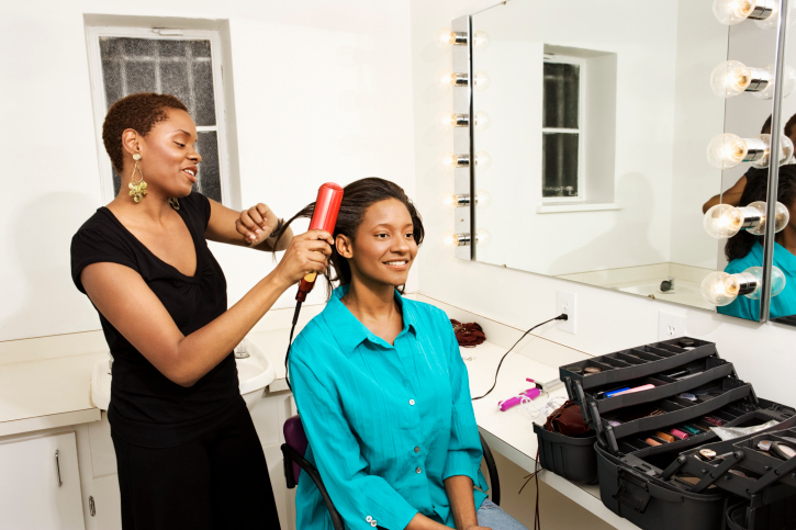 two african american women hair styling