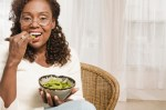 mature woman eating edamame