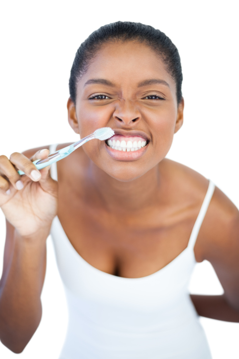 woman with toothbrush smiling