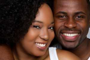african american man and woman smiling
