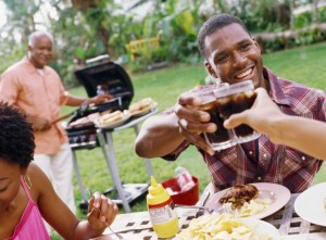 african american man toasting at a barbeque