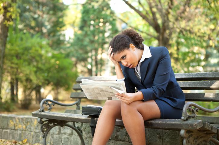 woman upset newspaper