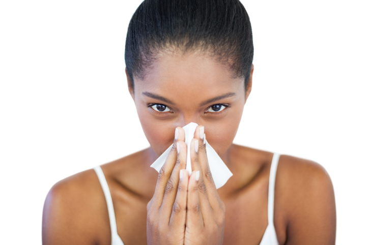 woman sneeze