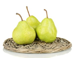 ripe pears on a wicker mat