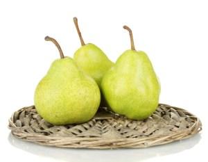 ripe pears on a wicker mat