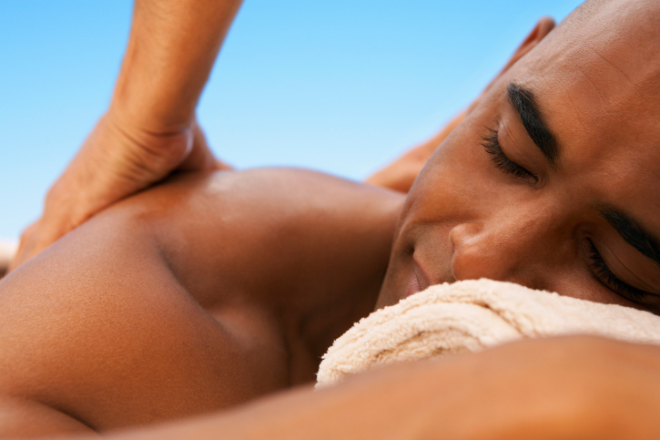 African American Black men getting massage