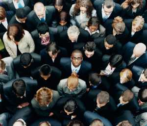 business man looking up in a group of people