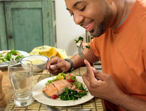 man eating a salmon salad for lunch