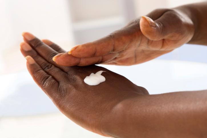 hand applying lotion