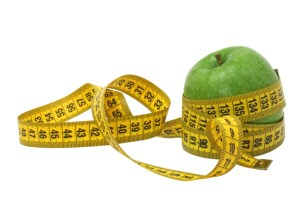 green apple wrapped in a tape measure