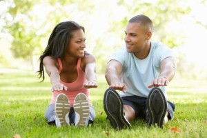 young african american couple exercising in the park