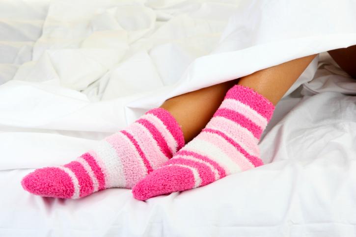 woman in bed socks