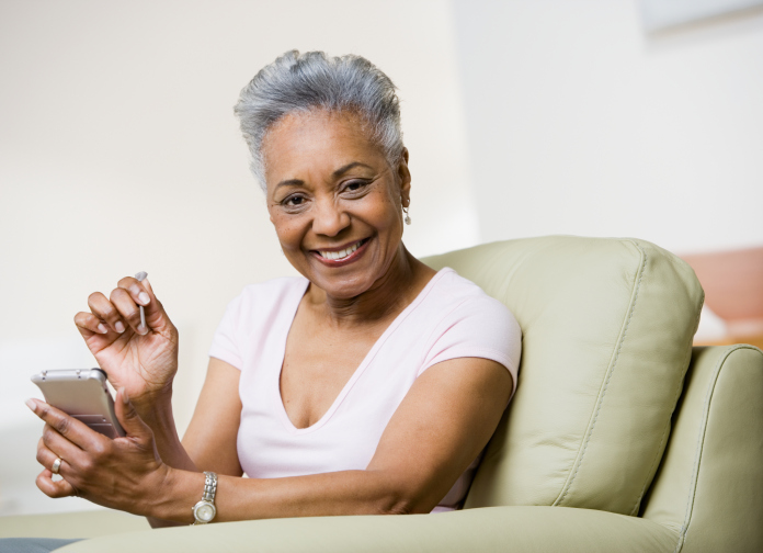 older woman with electronics