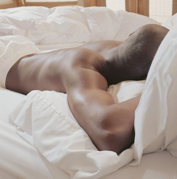 man sleeping bed
