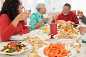 african american family sitting at a holiday dinner table