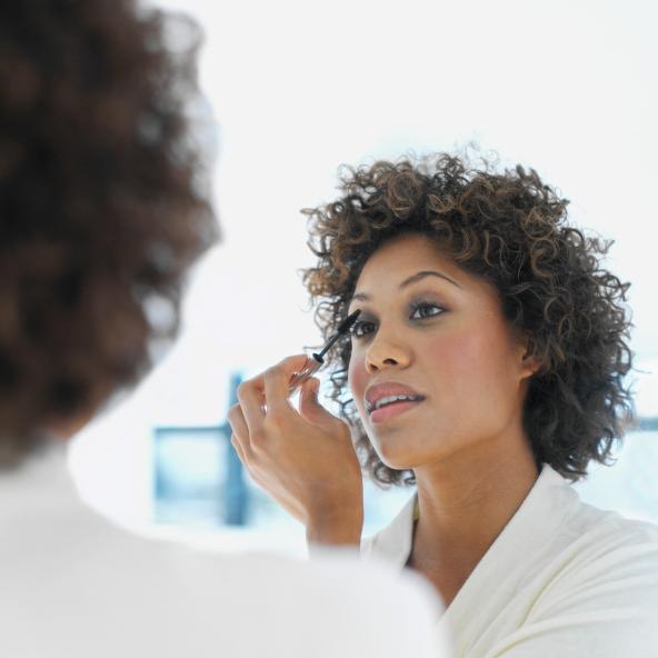 Close-up of a woman applying mascara