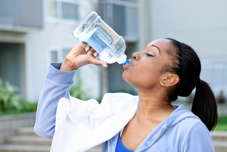 woman drinking gallon of water