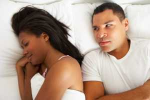 couple in bed with relationship difficulties
