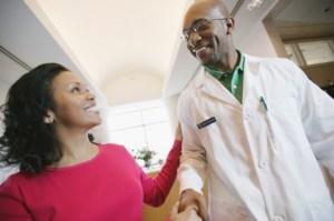 woman shaking doctors hand