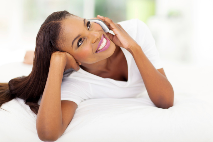 woman smiling cell phone