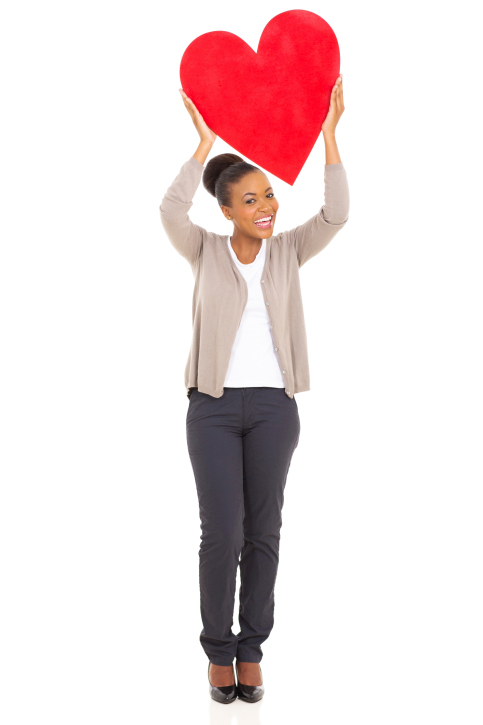 woman holding heart full length