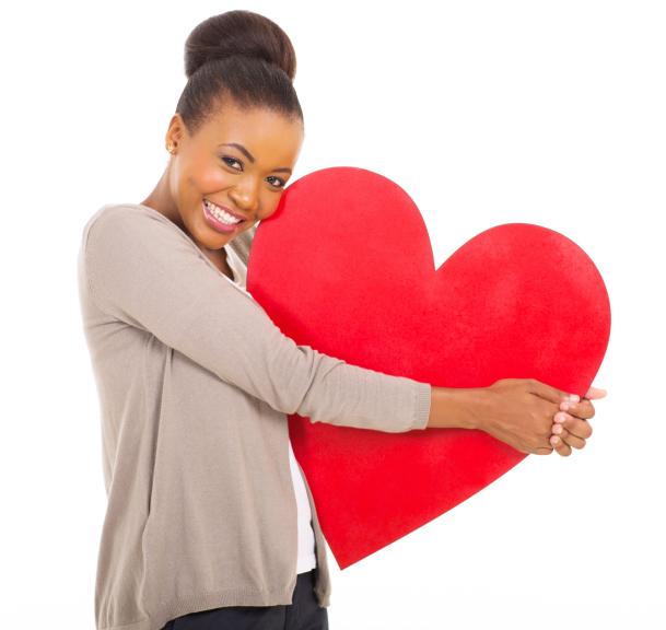 woman hugging large heart