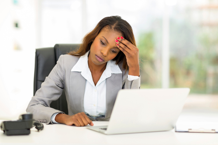 stressed woman at desk
