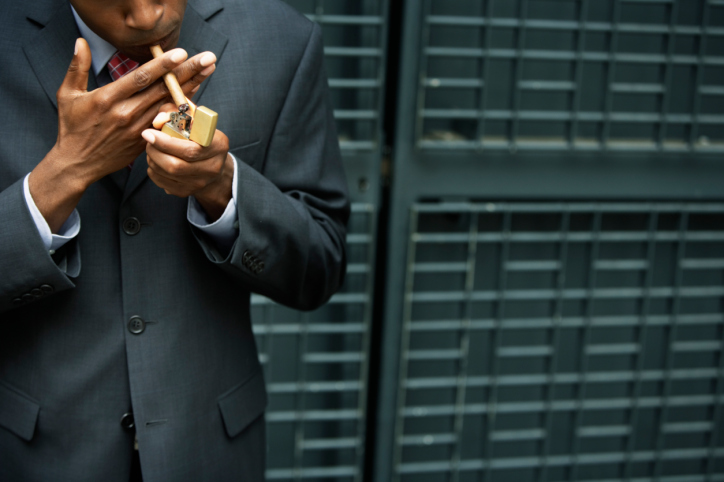 Businessman Lighting a Cigar