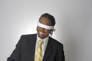 smiling blindfolded african american businessman