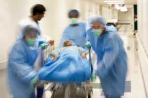 doctors rushing with patient on stretcher
