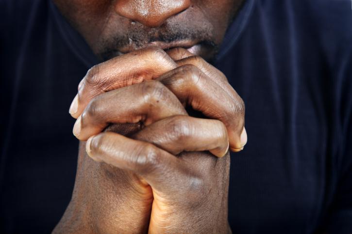 man in prayer close up