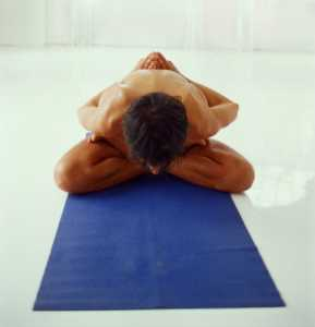 man in yoga position
